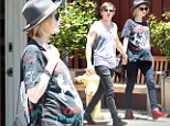 Rocker maternity wear: Evan Rachel Wood sported a large Van Halen T-shirt over her growing baby bump on Tuesday while out with British husband Jamie Bell in Los Angeles