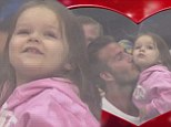 Daddy's girl! David Beckham cuddles up to daughter Harper on the KissCam during family outing