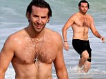 The best Hangover cure! Bradley Cooper strips to his trunks and takes a dip in the Rio ocean the morning after film premiere