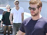 Is this the smile that says I'm a happily single man? Liam Hemsworth beams as it is claimed 'he has called off his engagement with Miley Cyrus'