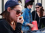 Rob who? Kristen Stewart puts on a brave face as she steps out with friends amidst rumours her ex is seeing other women