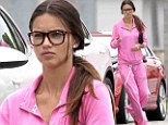 Not her usual attire! Adriana Lima hides her figure in baggy pink tracksuit and spectacles on errand run in rainy Miami