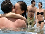 Wilde about the girl! Jason Sudeikis and his bikini clad fiance Olivia heat things up in the waters of Hawaii
