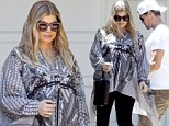 Pregnant and nesting Fergie protectively cradles her baby bump while house hunting with husband Josh Duhamel