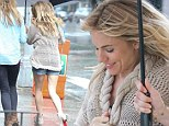 Running in the rain! Sienna Miller wears tiny denim shorts as she's caught out in wet and windy New York