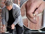 A series of images clearly show the veteran actor rummaging through the public ashtray outside a Los Angeles recording studio on Thursday.