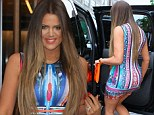Khloe Kardashian vies for pregnant Kim's crown in the bootylicious stakes as she shows off her slimline figure in brights