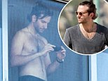 Rio de Janeiro, Brazil - Part 2 - Shirtless Bradley Cooper takes some pictures from his hotel