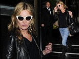 Kate Moss wears sunglasses after dark