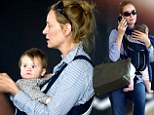 Back home! Make-up free Uma Thurman arrives in New York with baby Luna after Cannes festivities