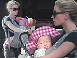 Down to a science! Anna Paquin takes her twin tots for a casual stroll around her Venice neighborhood without any help