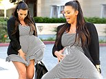 Even the weather's against her! Kim Kardashian wears an appropriate maternity dress... but the wind threatens her modesty