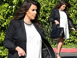 Room to move! Heavily pregnant Kim Kardashian finally opts for maternity wear as she steout in a billowing white dress and sensible sandals