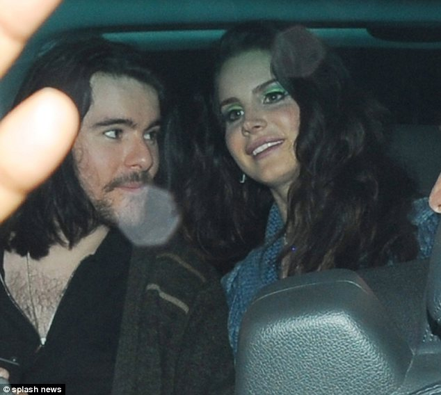 The look of love: Lana Del Rey's boyfriend Barrie-James O'Neil was seen staring at the singer in awe, as the pair left the Hammersmith Apollo