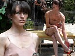 Milla Jovovich goes braless in flesh-coloured negligee for performance piece at Venice art festival