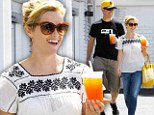 Reese Witherspoon and her husband Jim Toth are all smiles in matching sunny accessories after lunch