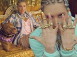 She's a tough girl now! Ke$ha dons a grill and cornrows for her new music video Crazy Kids ft. will.i.am