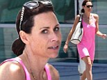 Make-up free Minnie Driver beats the Beverly Hills heat in hot pink mini-dress for lunch with a gal pal