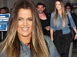 Keeping Up With The Chic! Khloe Kardashian continues her fashion trend as she jets to LAX in slim black trousers and denim blouse