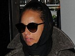 Glum: Alicia Keys wrapped up warm in a winter coat and head scarf as she arrives at her London hotel