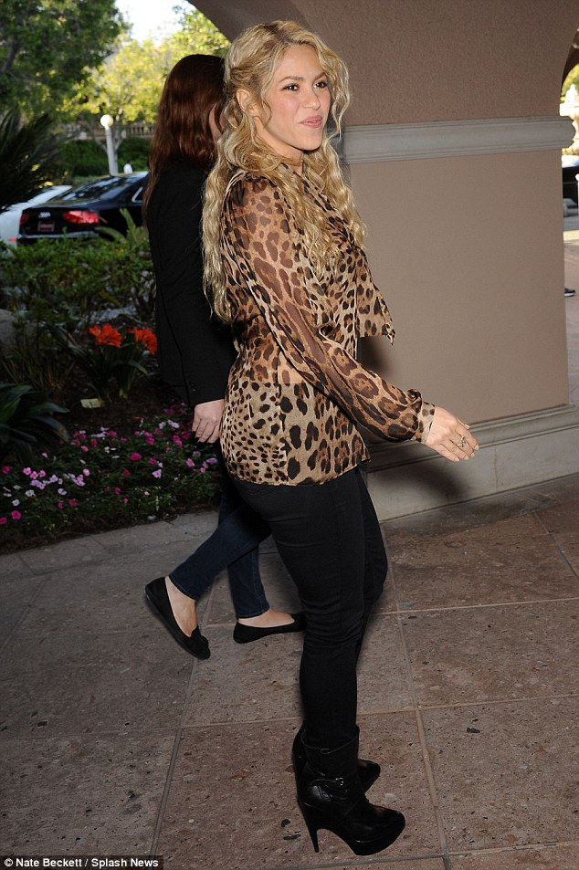 Sexy mama: Shakira added more flair with her pair of high-heeled boots