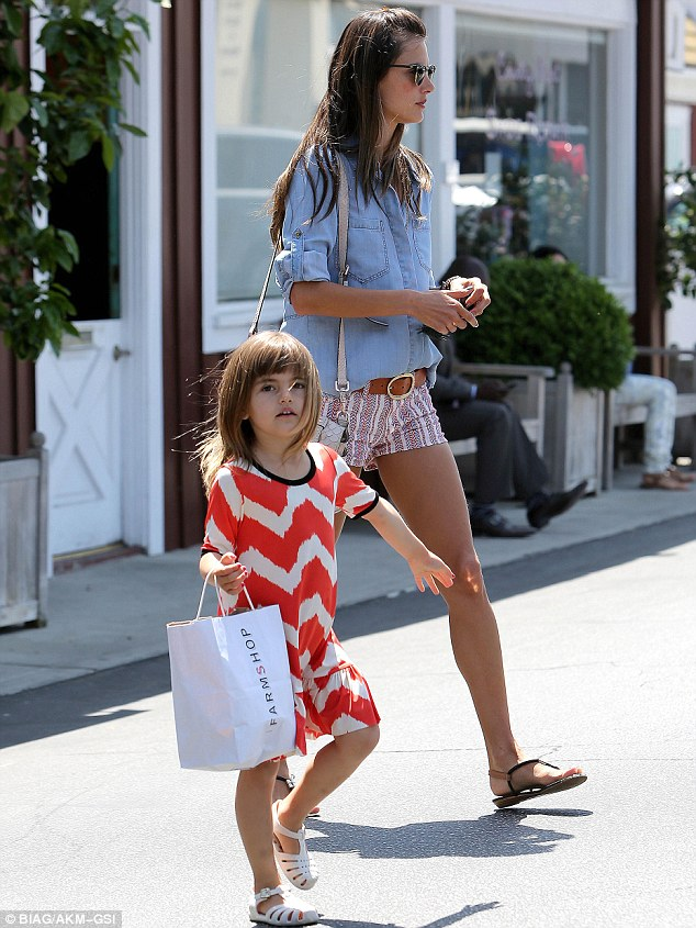 Following in her footsteps: By the time Anja is her mother's age she will be a retail therapy professional