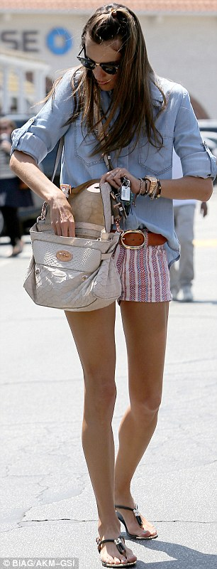 Slim pickings: The model's legs looked shapely and svelte as she padded around the Brentwood area