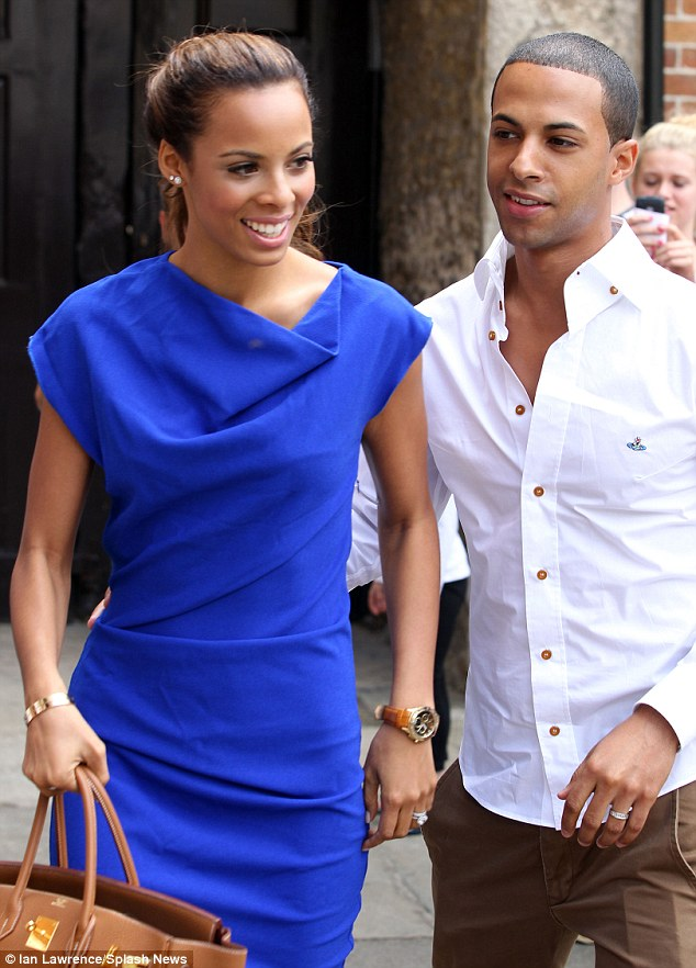 Husband and wife: Marvin Humes and Rochelle Wiseman make their debut as a married couple for the first time as they emerge the day after their wedding