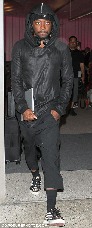 Typically stylish: Will.i.a.m looked cool as normal in an all-black ensemble