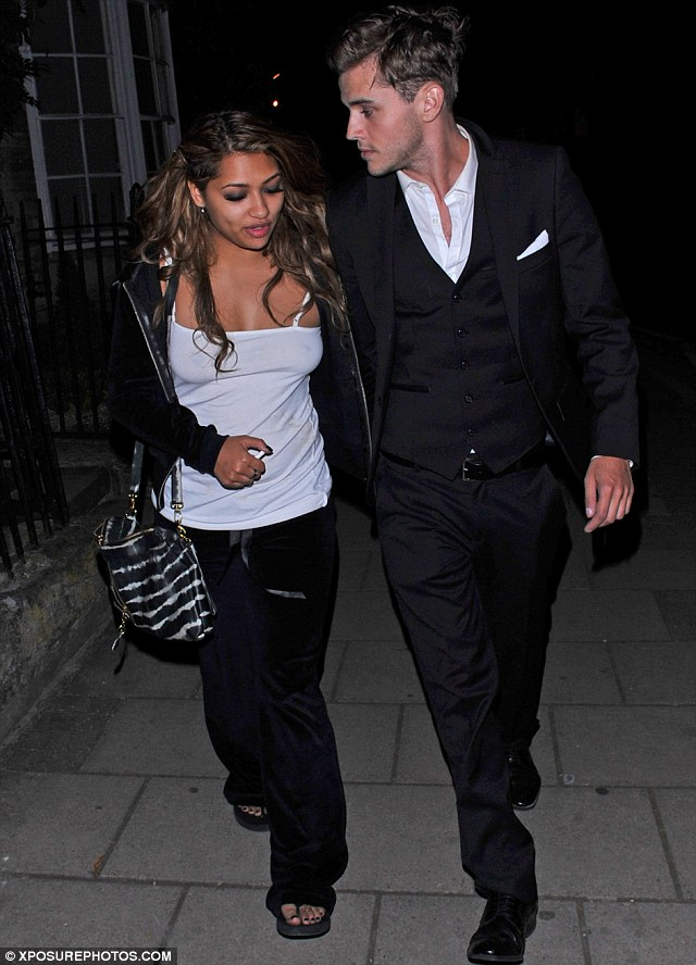 Homeward bound: Vanessa White and her boyfriend looked deep in conversation as they made their way home