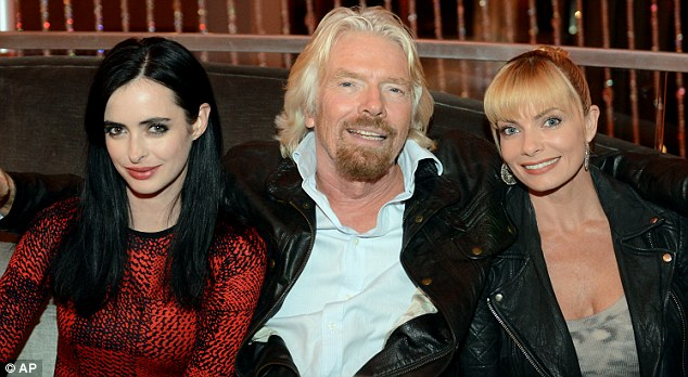 What's his secret? Once again the glamourpusses were eager to pose with the multi-billionaire