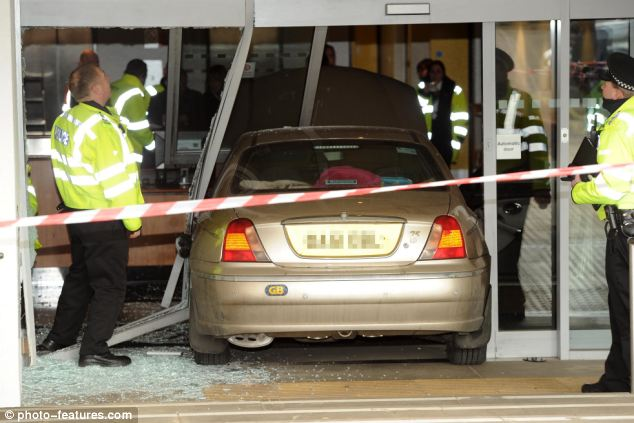 Big clean-up: The smashed doors of the Norwich job centre
