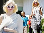 Different look: Gwen Stefani stopped out in a wrap that looked like a Toga as she took her sons Kingston and Zuma to Menchie's Frozen Yogurt in Studio City, California on Thursday