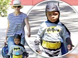 Mommy's little caped crusader! Sandra Bullock can't help but giggle as her super cute son Louis tries his best to look menacing in a Batman costume
