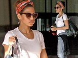 In the (land) army! Eva Mendes goes for retro chic as she accessorises her casual outfit with a quirky headscarf