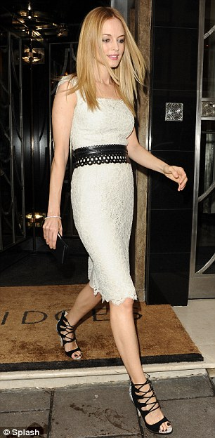 Mixing it: The star's dress featured both leather and lace and fitted her perfectly