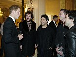 Prince Harry chats to members of the Stereophonics at the Walking With The Wounded Crystal Ball Gala Dinner last night