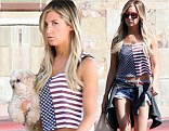 All American! Ashley Tisdale shows her patriotic side as she teams a stars and stripes crop top with denim shorts