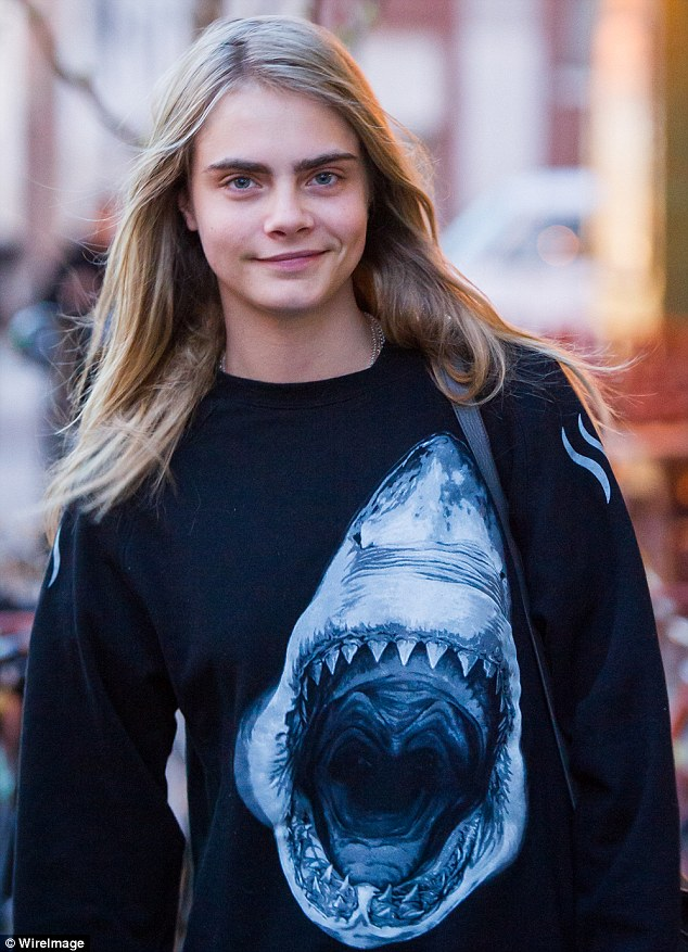 A Jaws-dropping new look: Cara Delevingne stepped out in New York on Monday wearing a jumper printed with a fearsome shark