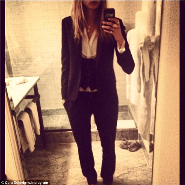 Dressed to impress: Cara can also do super-smart, as she demonstrates in her Saint Laurent Paris suit
