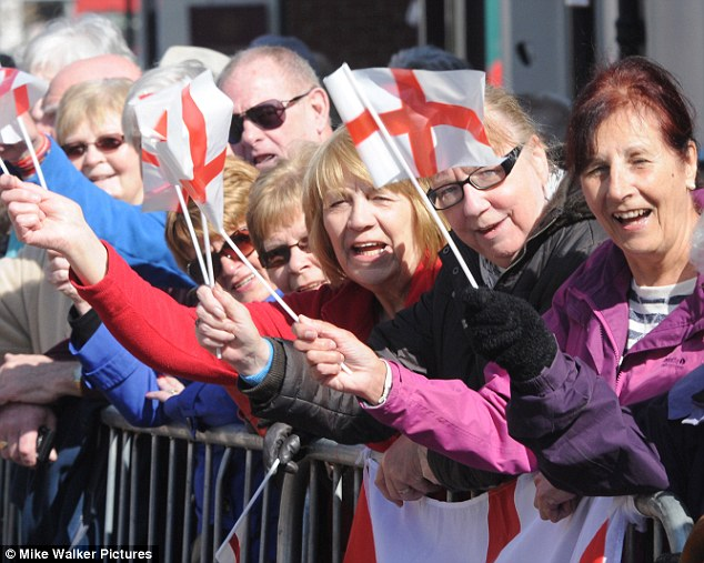 Best of English: The crowds wave flags in Emsworth as soldiers march through the town to mark St George's Day
