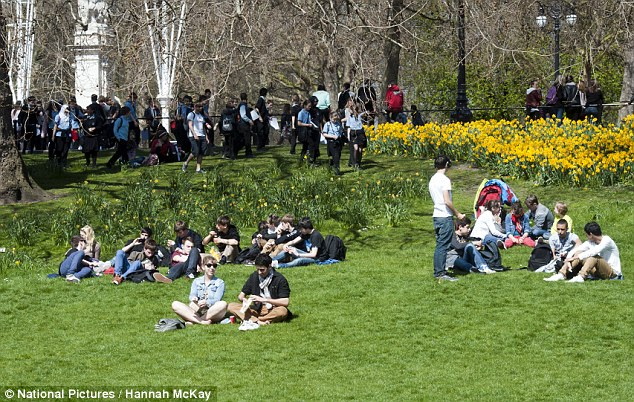 Pleasant weather: People gather in St James's Park today as London heats up for St George's Day