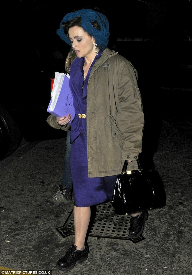 Granny style: Helena Bonham Carter looked grungy as she had a break in between takes on Burton and Taylor in London on Monday