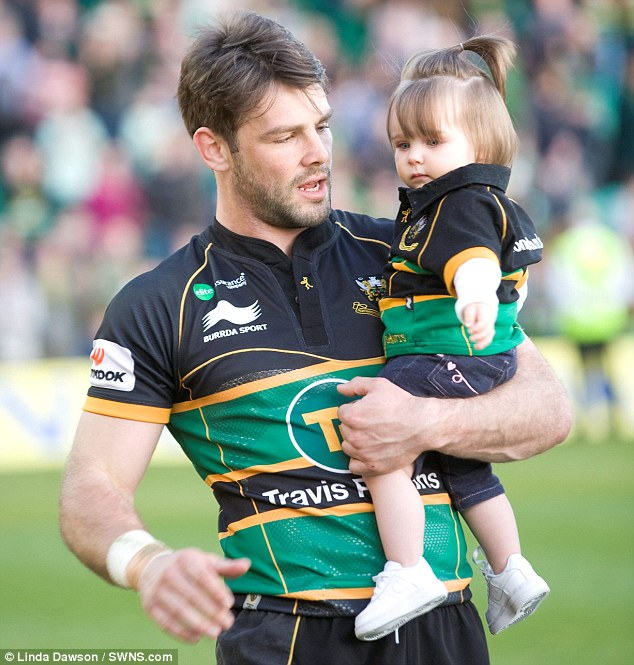 Proud dad: After the game ended, Ben went and got Aoife from her seat and proudly paraded her around the pitch