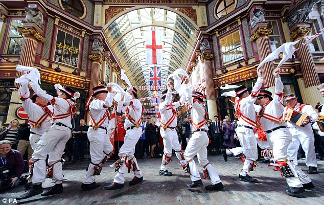A group of Morris Dancers perform as part of St George's Day celebrations in Leadenhall Market