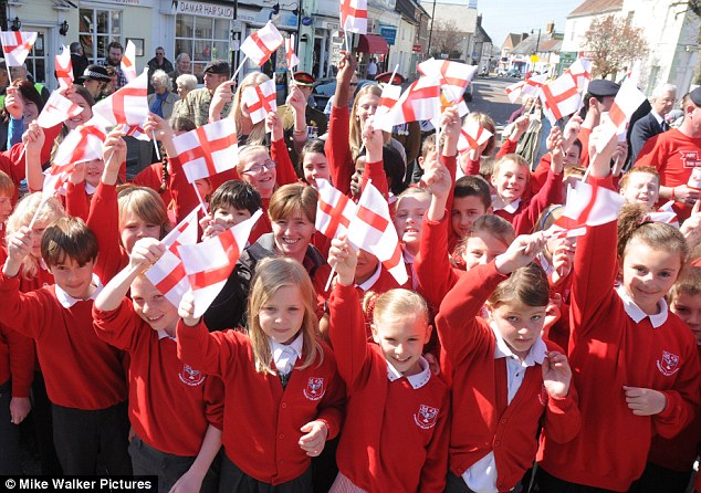 Crosses of St George: The children wave their flags on St George's Day today in Emsworth, West Sussex