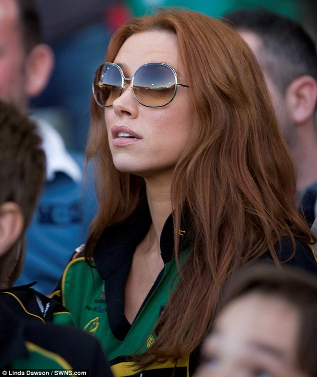 Doting wife: The glamorous singer watched nervously from the stands as her scrum-half husband worked his magic on the pitch