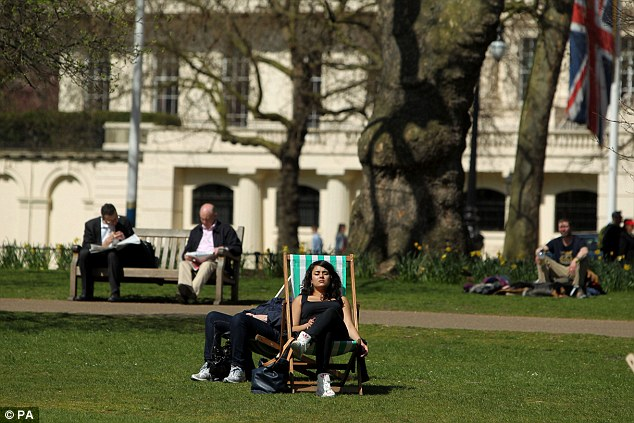 Sunbathing: People enjoy the spring sunshine in St. James's Park in central London as the country warmed up