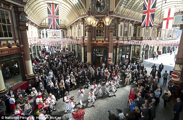 St George's celebrations: Morris dancers perform to a crowd of people in Leadenhall market today to mark April 23