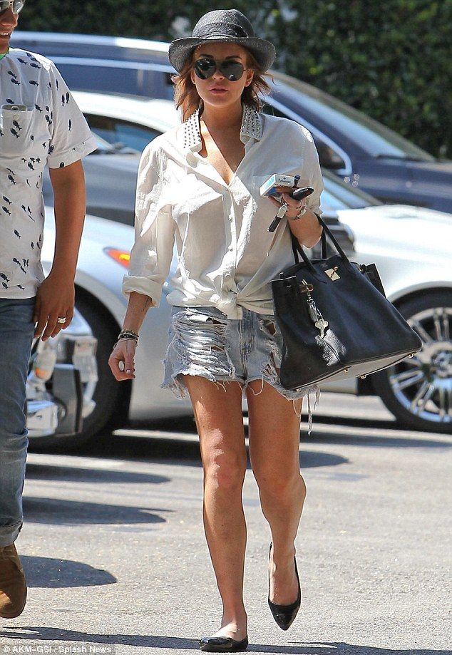 Ripped: Lindsay Lohan stepped out for lunch in West Hollywood today in a less-than-flattering pair of shorts